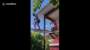 item: 'Backyard Olympian attempts to dive into a pool from a homemade diving board'