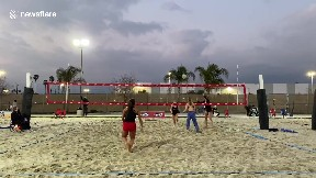 item: 'Beach volleyball player dives for a ball and does a scorpion fail'