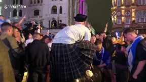 item: 'D'oh! Drunk Scotish soccer fan fall of trash bin in Leicester Square'