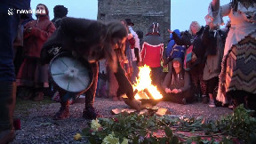 item: 'Daybreak celebrations at Glastonbury Tor summer solstice in spite of the overcast weather'