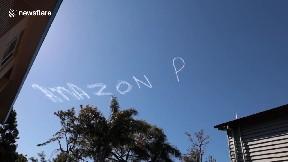 item: 'Skywriting aircraft scrawls 'Amazon Prime Day' in skies above Brisbane in Australia'