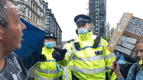 item: 'Police officers shove anti-lockdown protesters away from road during London rally'