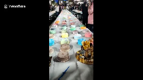 item: 'Indian man goes all out for his birthday with 550 different cakes'