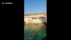 item: 'CANNONBALL! Guy backflips off cliff into Cyprus waters and bellyflops'