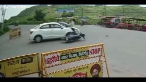 item: 'Biker crashes into car ... but sticks perfect landing'