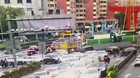 item: 'Falling crane crushes car trapping driver inside in China'