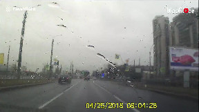 item: 'Russian driver slams into light pole, knocking it over onto passing vehicles'