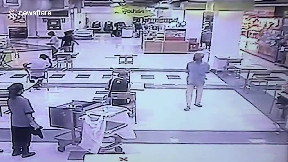 item: 'Hero shopper trips over armed robber trying to escape from scene'