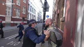 item: 'Policewoman claims she was 'punched' by protester at 'anti-vaccine passport' demo in London'
